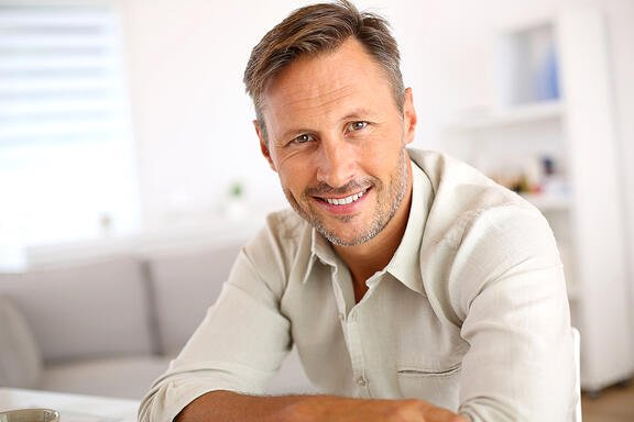 Attractive smiling man relaxing at home-1