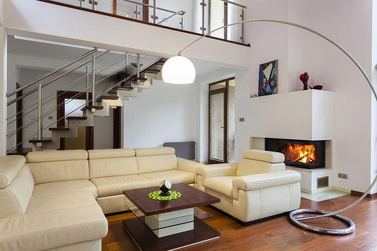 Big and comfortable living room with bright sofa