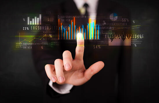 Business person touching colorful charts and diagrams-1