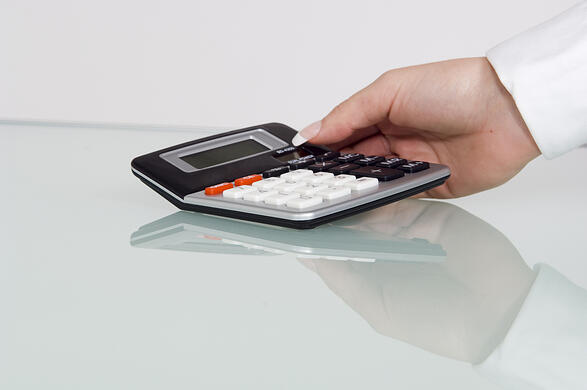 Calculator being picked up.