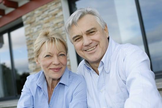 Cheerful senior couple looking at camera
