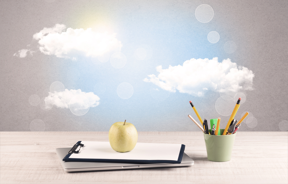 Close up of business office desk concept with clouds, blue sky and sunshine