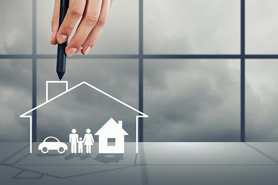 Close up of human hand drawing happy family and real estate concept-1