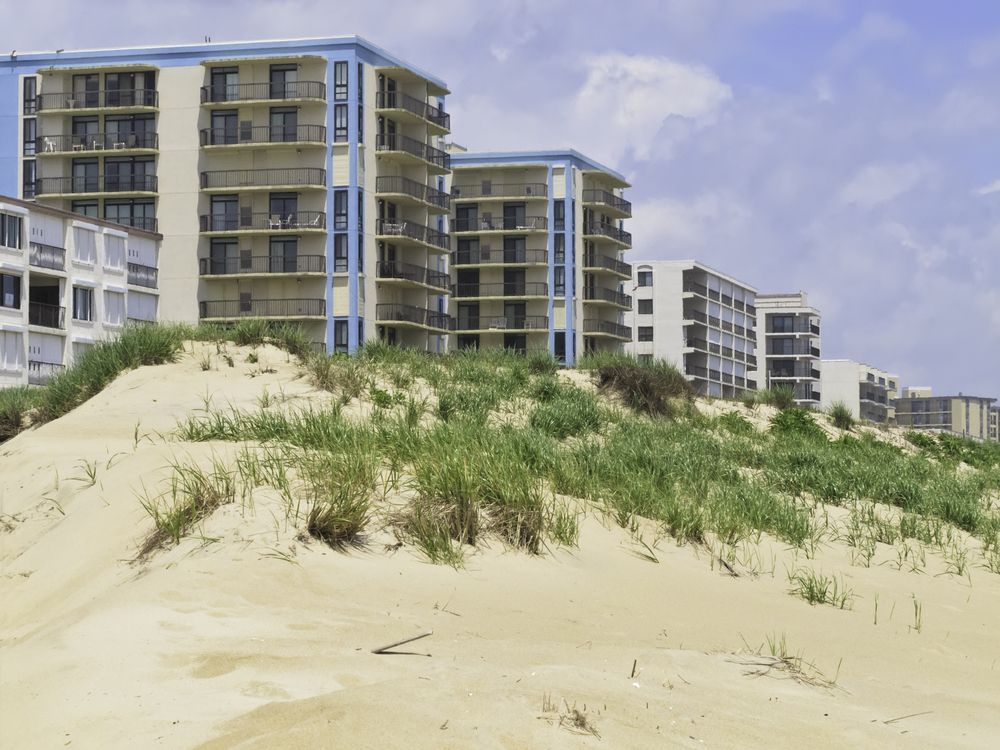 Coastal landscape Row of high-rises with ocean views by dune along beach in Ocean City, Maryland