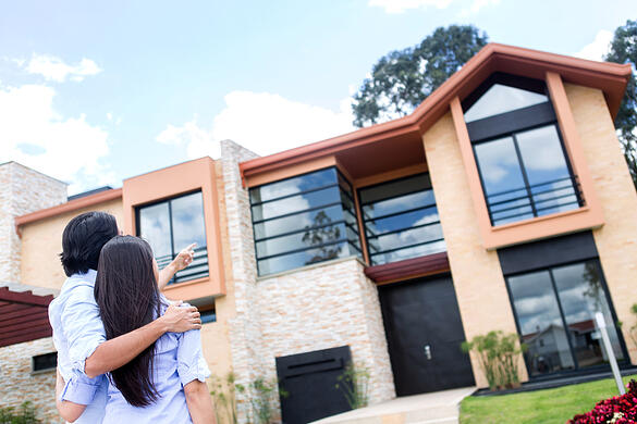 Couple looking at a beautiful house to buy