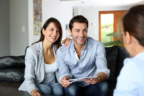 Couple meeting consultant for financial contract-1