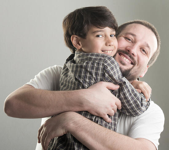 Dad and little son hugging