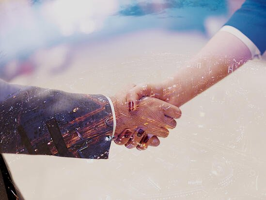 Double exposure design. Business partners concept with businessman and businesswoman handshake at modern office indoors