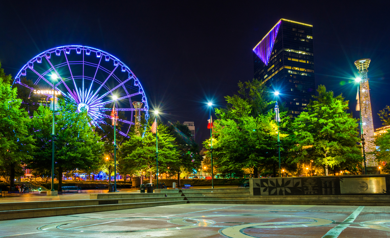 Ferris wheel and buildings seen from Olympic Centennial Park at night in Atlanta, Georgia.
