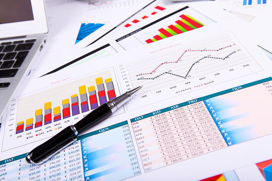 Financial paper charts and graphs on the table-3