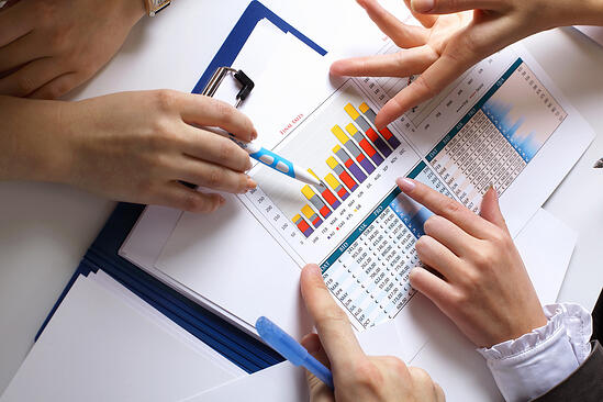 Financial paper charts and graphs on the table-Aug-30-2020-11-18-38-42-AM