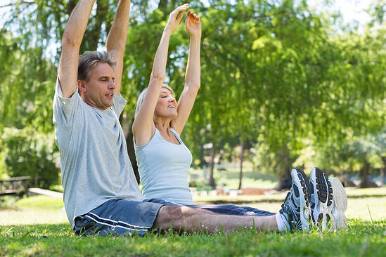 Full length of couple exercising together in the park-1