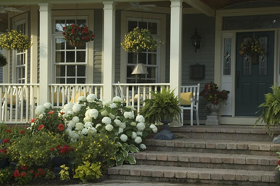 Glow of summer sunrise on front porch of suburban house-1