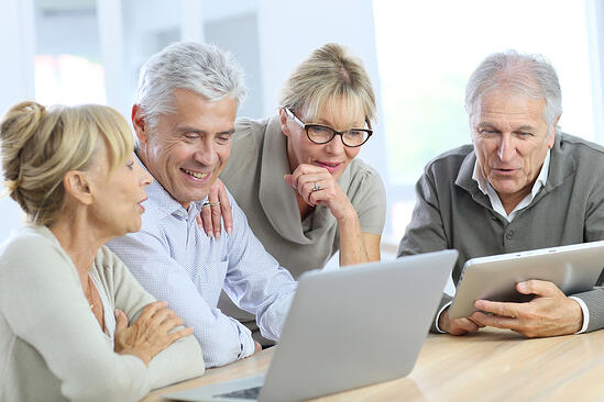 Group of retired senior people using laptop and tablet-1