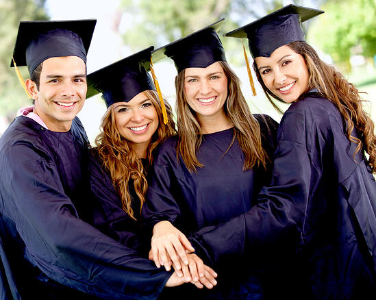 Group of students in their graduation with hands together - teamwork concepts