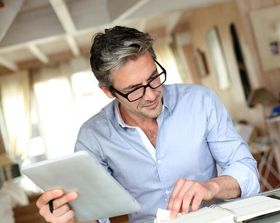 Handsome businessman with eyeglasses working from home-1