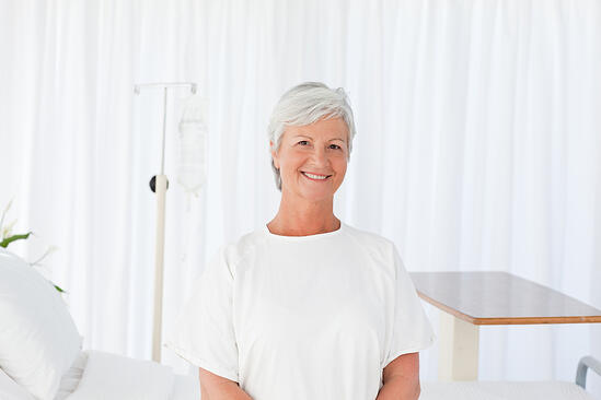 Happy woman  looking at the camera in a hospital