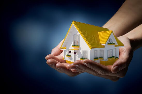 Human hands holding model of dream house-1