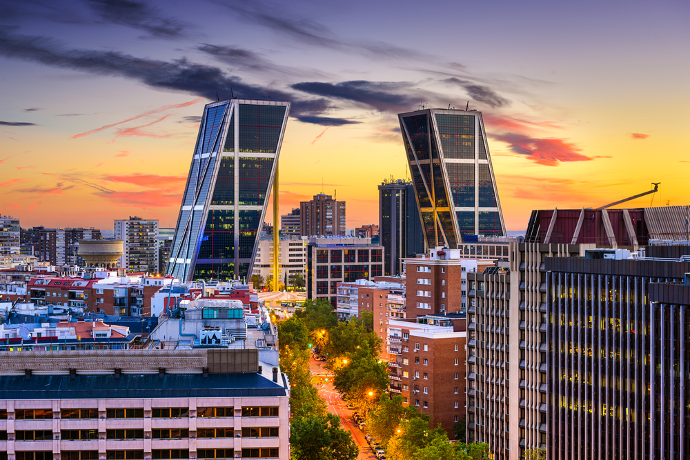 Madrid, Spain financial district skyline at twilight viewed towards the Gates of Europe.-1