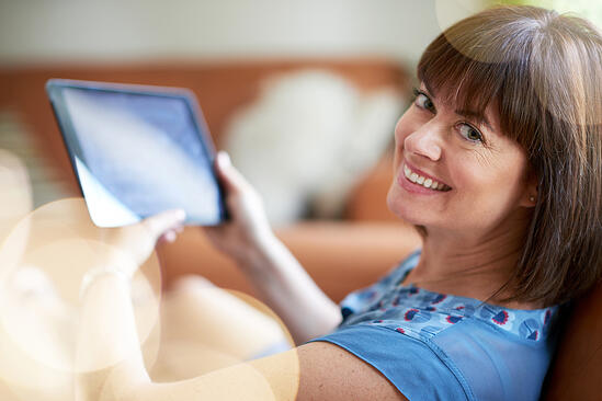 Mature woman browsing the internet on a digital tablet-2