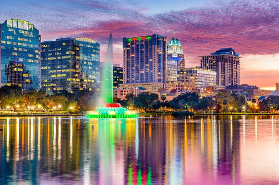 Orlando, Florida, USA skyline at dusk on Eola Lake.