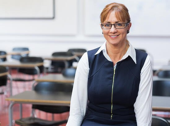 Portrait of a smiling female teacher in the class room