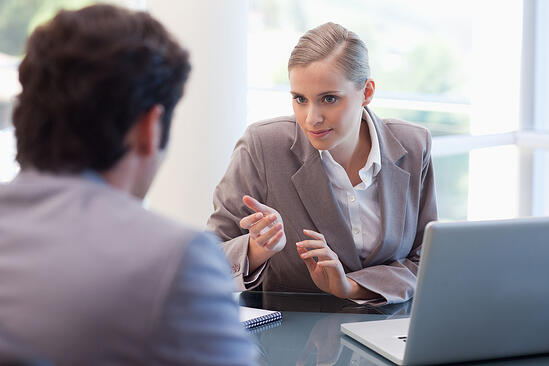 Professional businesswoman receiving a customer in her office