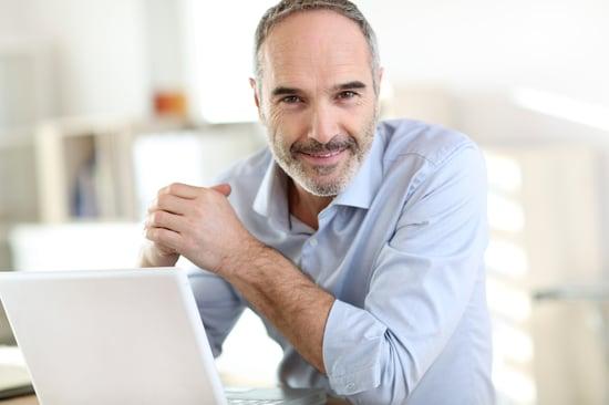 Senior businessman working on laptop computer