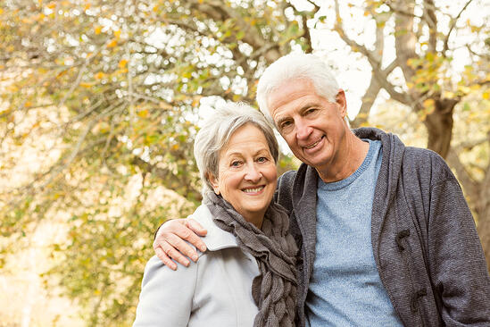 Senior couple in the park on an autumns day-1