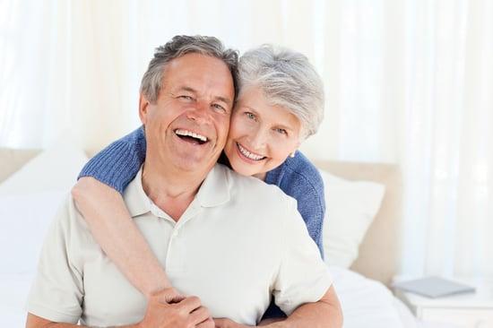 Senior couple looking at the camera  at home-2