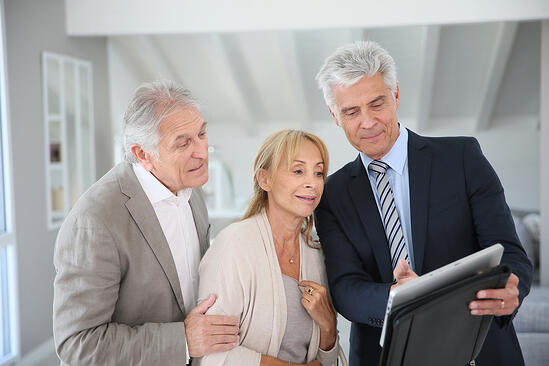 Senior couple with real-estate agent visiting house for sale-2
