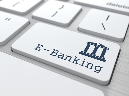 White Button with E-Banking Icon on Computer Keyboard. Business Concept.
