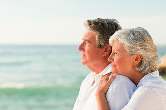 Woman hugging her husband at the beach-3