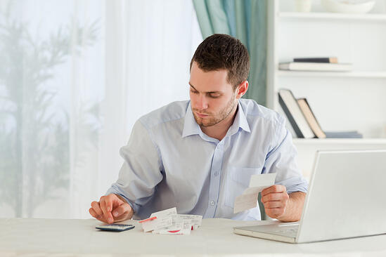Young businessman calculating-1