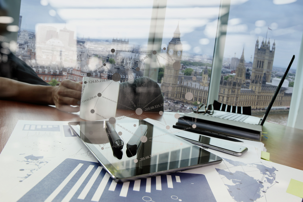 business documents on office table with smart phone and digital tablet and graph business diagram and man working in the background-2