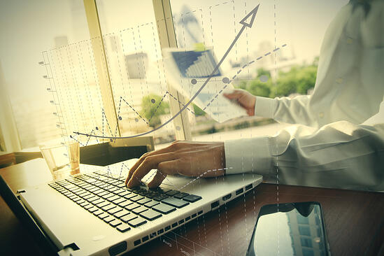 business documents on office table with smart phone and digital tablet and graph business diagram and man working in the background-3