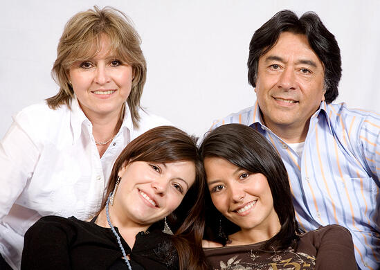 latin american family over a light grey background